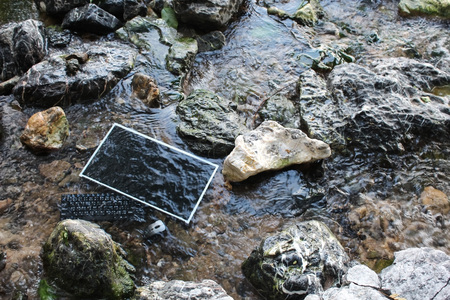The computer under the surface of the water in a waterfall,Screen with keyboard and mouse. 版權商用圖片 - 70292103