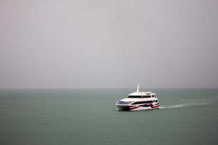 Speed boat sailing in fog, rain,Travel and transportation In the rainy season and the monsoon in Thailand