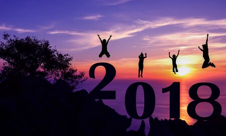 next year: New year 2018 with family jumping on the mountain background.