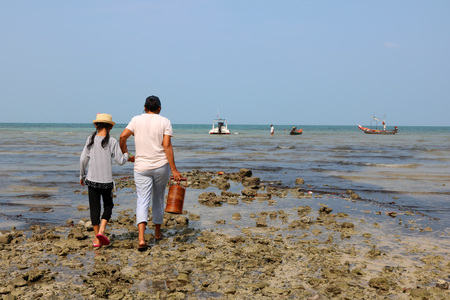 Local fishermen family with boat on the beach. Stock Photo