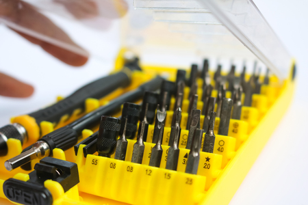 hardware: A series of small screwdriver set for tightening electronics device in white background.