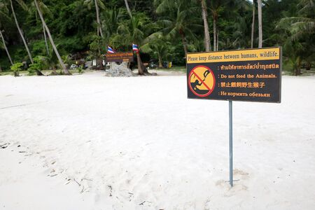 Multilanguage sign languages for dont feed the animals on the beach in Thailand.