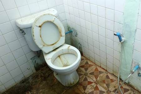 very dirty: Dirty old toilets bowl and the bathrooms is not very clean Stock Photo