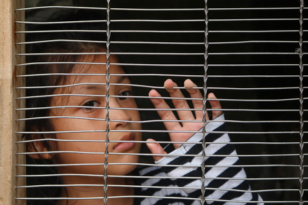 Asian girl children in the cage, Human trafficking concept