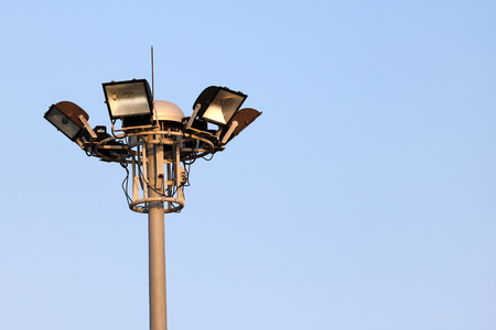 The stadium lights on poles with the blue sky. Stock Photo