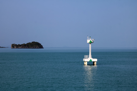 White buoy Navigation or lateral Marks floating in the sea,Gulf of Thailand. Banco de Imagens