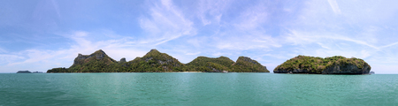 Panorama views of tropical islands and sand beach against the blue sky at Ang Thong archipelago at Samui,  Thailand