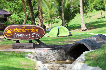 Camping Site sign in the national park in Thailand,  Thai language means that camping area.