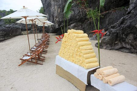 Towels are ready for visitors to the tropical beach in Thailand.