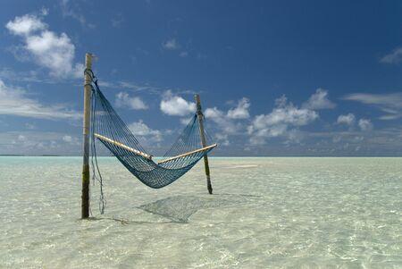 colour intensity: Hammock lying in a shallow Maldivian Lagoon