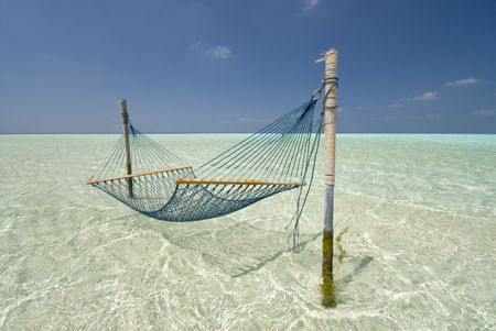 enticing: Hammock lying in a shallow Maldivian Lagoon