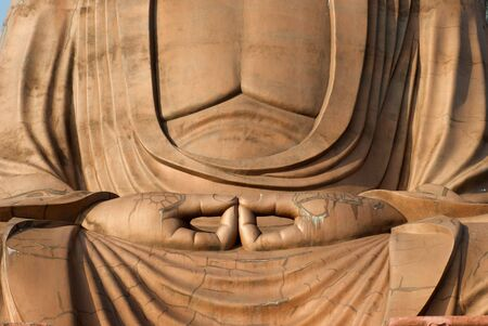 Zen buddha sits with hands in meditation position Stock Photo - 5458712