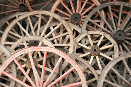 Collection of old wagon wheels photo