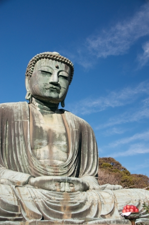 Giant Buddha at Kamakura, Japan. Seated on left, red apples on bottom right photo
