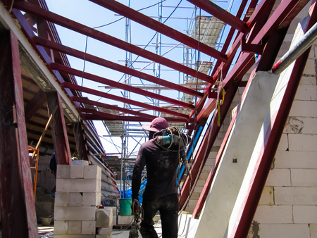 The building is under construction, roof steel frame for building construction, large steel frame. Stock fotó