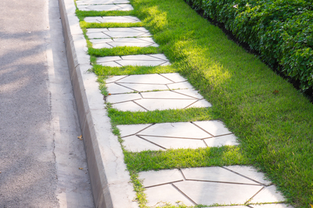 Green lawn, Beautiful stepping stone pathway with green lawn,walkway in the garden, garden landscape design.