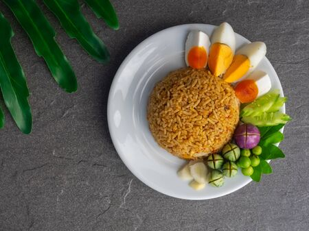 Shrimp paste sauce fried rice with boiled egg and vegetables on white plate, Thai menu call Naam Phrik Lohng Rua, Healthy Thai food. Stock Photo