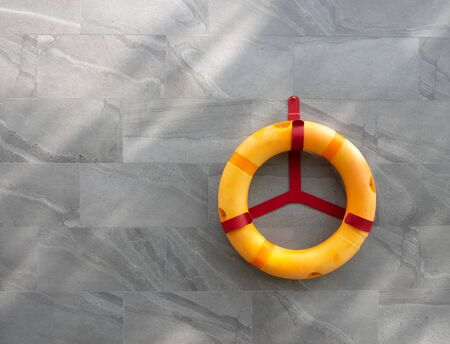 lifebuoy is hanging on the steel, rescue equipment for swimming pool, help and safety, blank space for text