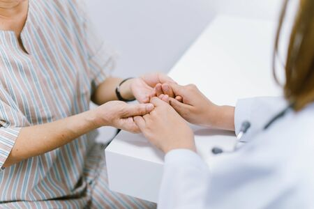 close up doctor hold hand of senior patient , medical care responsibility Banco de Imagens