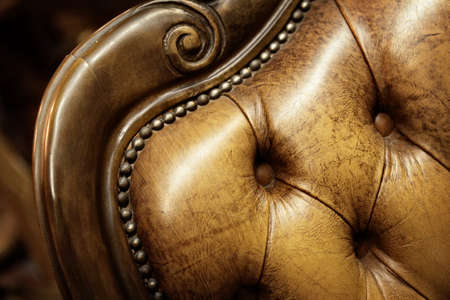 vintage furniture: close up of a brown chair with wooden finish Stock Photo