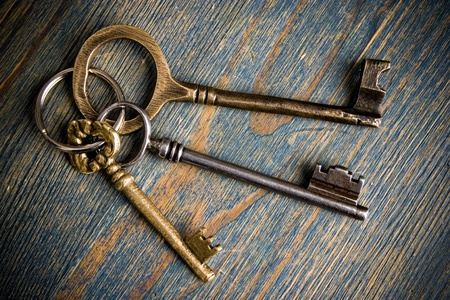antique key: three keys on wooden table Stock Photo