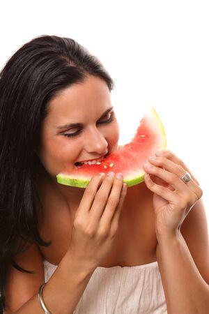 スイカの部分を食べることの女性の写真 写真素材