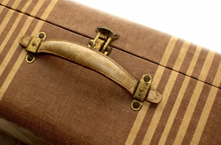 an old suitcase in shades of tan with beige stripes
