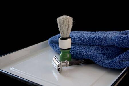 bygone days: razor, brush and towel on a white tray Stock Photo
