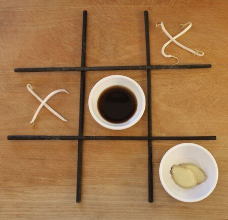 Bean sprouts are the x's and round white dishes of soy sauce and ginger