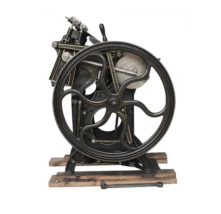 a black 1901 printing press with gold trim, isolated