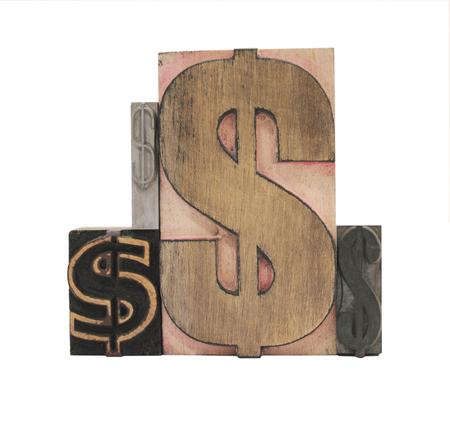 signos de pesos: cuatro signos de d�lar en el viejo letterpress tipos de madera y metal, aislado en blanco