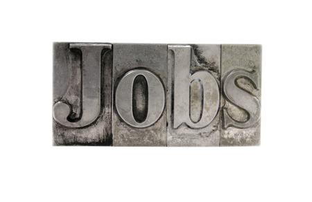 Vieux, taché d'encre typographique métal type énonce le mot «emploi» isolé sur blanc  Banque d'images - 1490371
