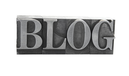 old, ink-stained metal letterpress type spells out the word 'Blog' isolated on white Stock Photo - 1490375
