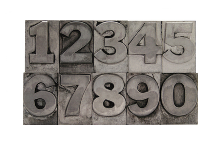 old, inkstained numbers in letterpress lead type