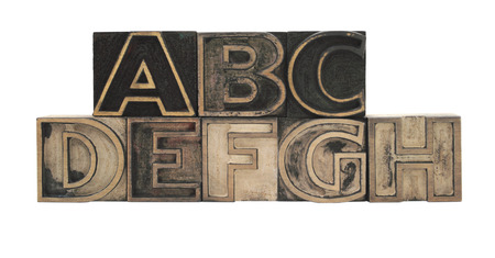 letterpress letters: old, inkstained letterpress wood outline type letters A-H