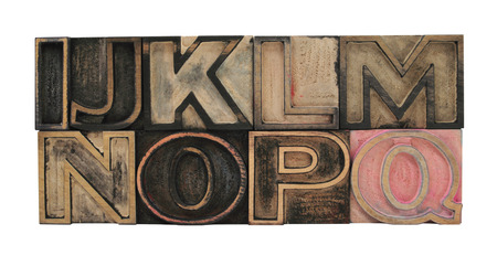 letterpress letters: old, inkstained letterpress wood outline type letters I-Q Stock Photo