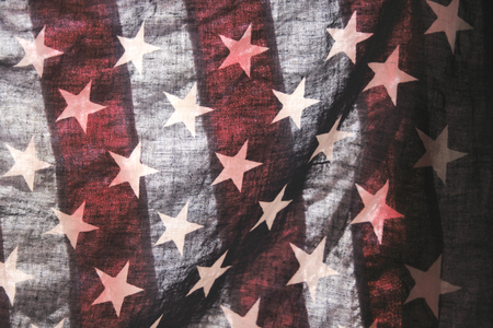 forefathers: backlit old American flag showing stars over stripes Stock Photo
