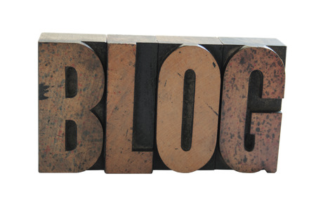 old, inkstained wood letterpress type spells out the word 'blog' in all caps Stock Photo - 1490398