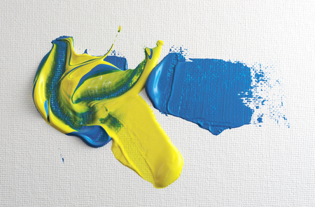 blue and yellow paint applied to canvas with a palette knife