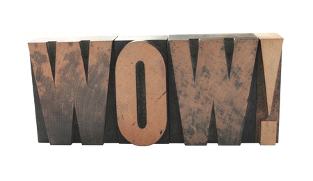 letterpress letters: old, ink-stained letterpress wood type letters form the word WOW