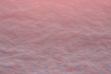 a background in shades of orange and blue with faint spots in the lower half Stock Photo