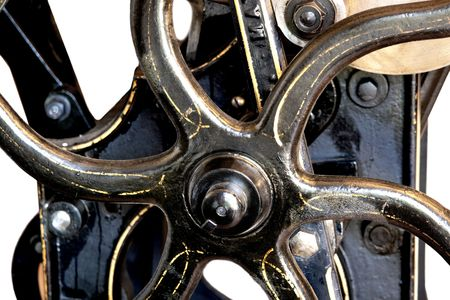 flywheel: close-up view of a restored antique black letterpress shows the rare gold detailing