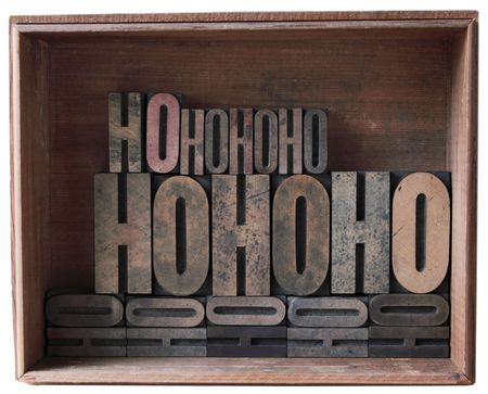 a wooden box filled with 'ho ho ho' in different sizes of wood type