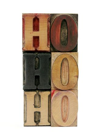 the phrase 'ho ho ho' in letterpress wood letters isolated on white Banque d'images