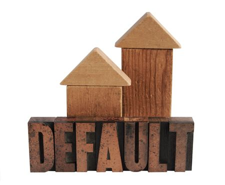 the word 'default' in old letterpress wood letters with two shapes in wood blocks that could be either houses or arrows pointing upward