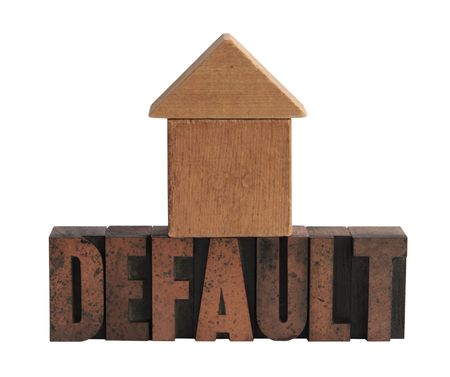 default: the word default in old letterpress wood letters with a wood blocks shape that could be either a house or an arrow pointing upward Stock Photo