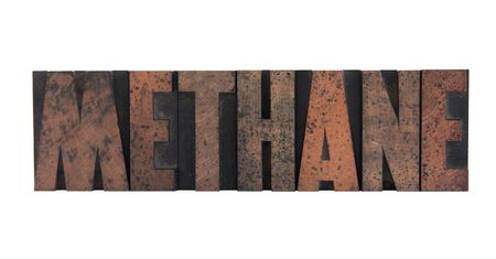 the word methane in old, ink-stained wood letters isolated on white Stock Photo
