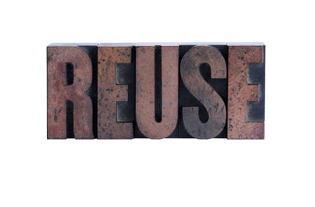 the word reuse in ink-stained wood letters isolated on white