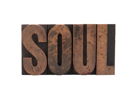 the word 'soul' in old, ink-stained wood letters isolated on white Archivio Fotografico