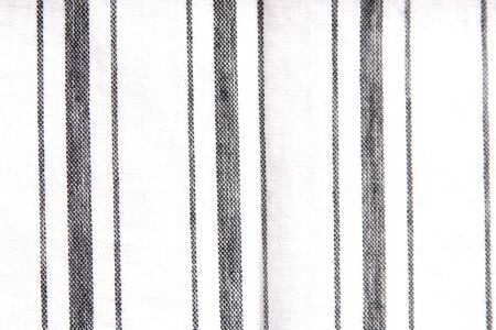 alternating thick and thin stripes on white fabric